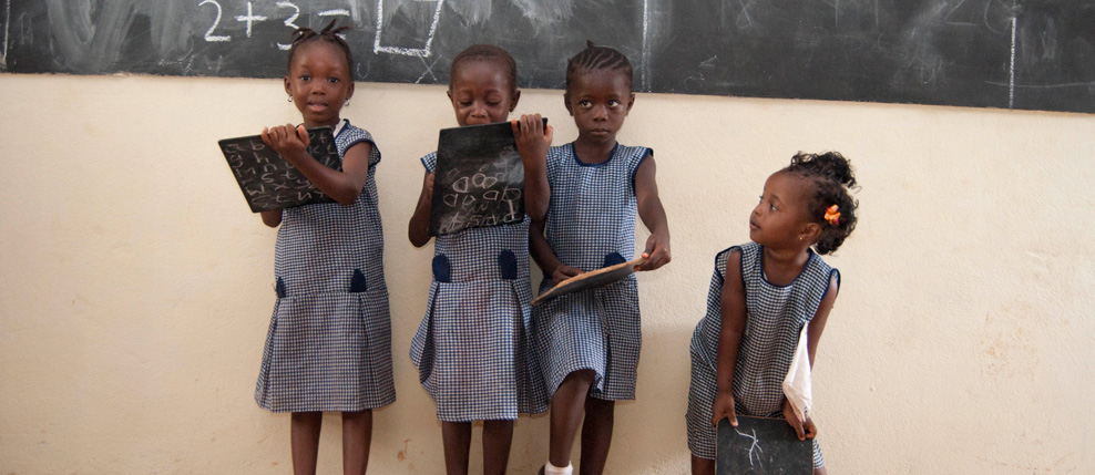 Kariah Sherrif (L), Mary Koroma (Second on left), Zainab Sesay (Second on right) & Millicent Kamara (R) in the kindergarten at Kola Tree Community School, Western Area, Sierra Leone