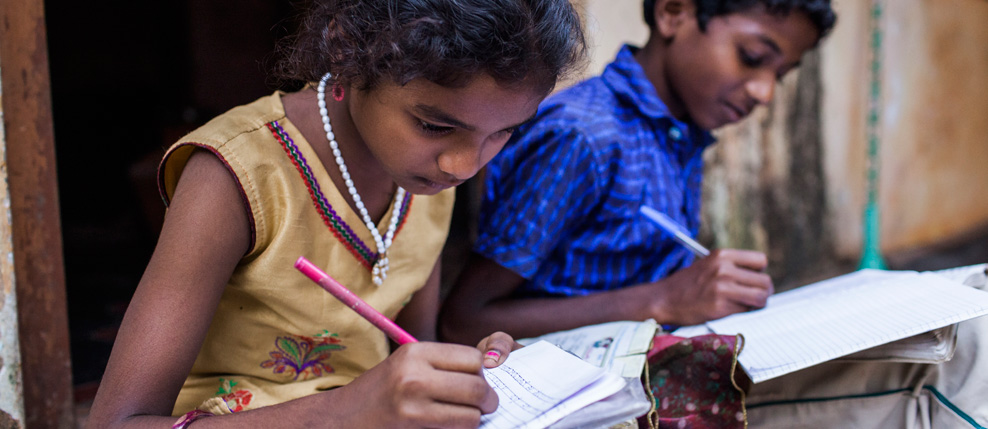 India. Karnataka. Udupi district. Keerthana (9) and Sharan (12) are doing their homework in front of their house in the village of Ramanagara. 26.11.2014