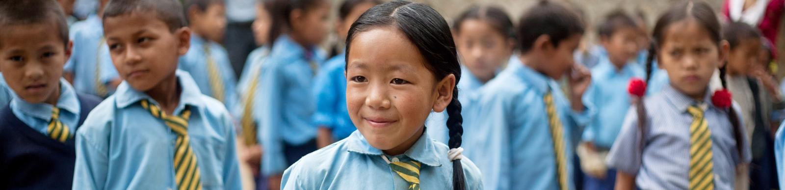 Sanju Rai, 9, during the morning assembly in the school in Nepal