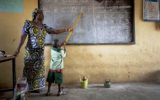 Ladi T. Danlami with schoolchildren in Yangoji Primary School where she is a teacher, Abuja State, Nigeria on the 4th October, 2012.