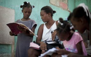 Nadege Auguste teaches her daughters at home. Access to education is a huge challenge in Haiti