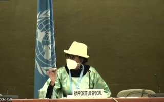 Special Rapporteur Dr Koumbou Boly Barry presenting her report