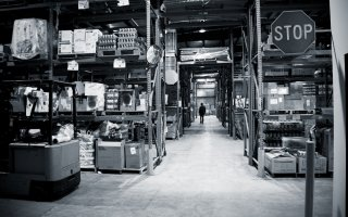 Black and white image of a food bank warehouse