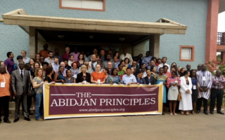 Abidjan Principles signatories with banner
