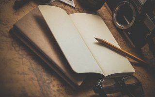 brown pencil on white notebook